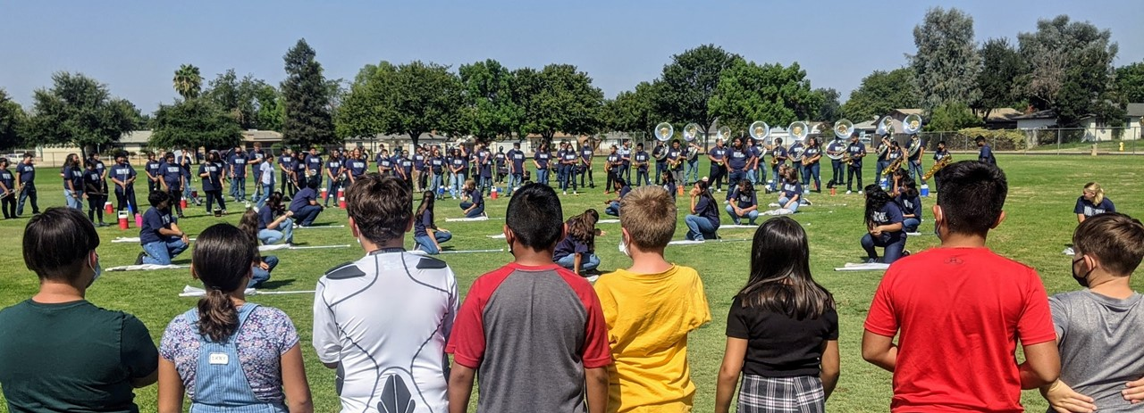 miramonte students watching clovis east marching band perform