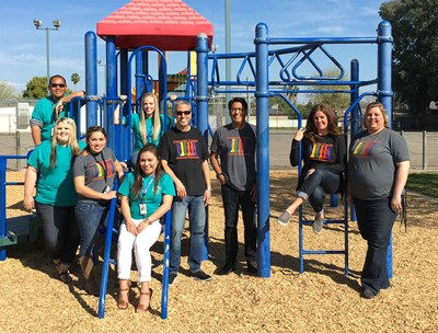 Group of staff on playground posing together